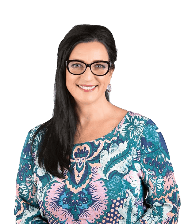 woman with dark hair and glasses smiling